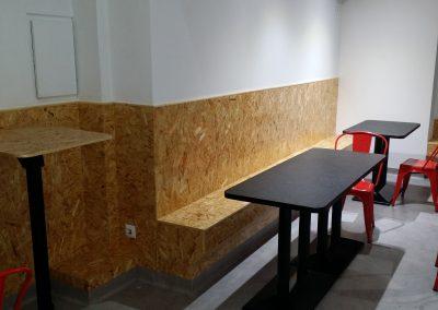Interior recubrimiento zona de asiento y mesas